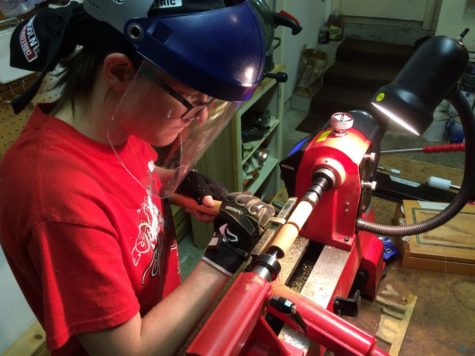 Coppell High School junior Emily Evans works on creating one of her many homemade wooden pens. Evans has been making unique pens since her 16th birthday after receiving a lathe, which is a device that is used to shape wood while being rotated on an axis. Photo courtesy Emily Evans.