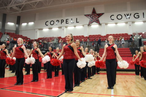 Coppell High School junior Kristen Lason stands proudly and smiles with the Lariettes in the front line at the pep rally against the Allen Eagles last Friday in the new arena. Lason has the role as one of the Junior Lieutenants of the Lariettes, the Coppell dance team. Photo by Hannah Tucker.