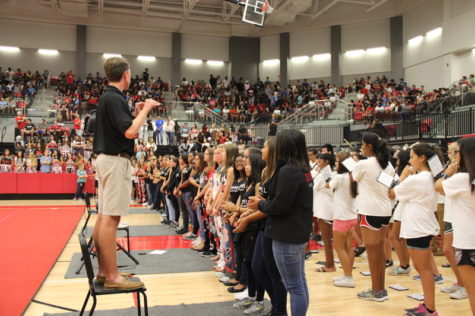 """oppell High School senior Kyle Whiting leads the band on, along with the other drum majors, while they play a variety of stand tunes at the pep rally against the Allen Eagles last Friday in the new arena. The entire band of approximately 400 attends each pep rally, playing songs varying from old classics, like """"Hey Baby"""" to songs like """"That's What I Like About You"""", and of course, the beloved fight song and alma mater. Photo by Hannah Tucker."""