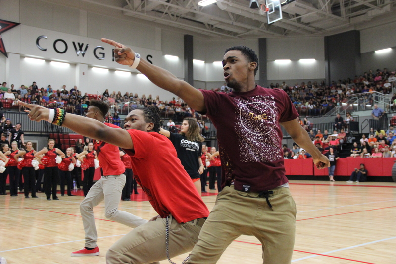 Coppell+High+School+seniors+Christian+McDow+and+Devon+Hawkins+pose+and+point+to+the+crowd+as+they+end+their+dance+routine+at+the+pep+rally+against+the+Allen+Eagles+last+Friday+in+the+arena.+Both+have+a+pursuit+in+break+dancing+and+seem+to+complete+difficult+looking+tasks+and+moves+while+other+audience+members+like+to+jump+in+and+join.+Photo+by+Hannah+Tucker.