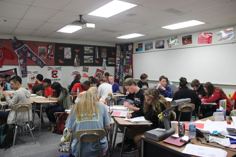 Coppell High School students in Ms. Bourg's AP calculus AB class work on their homework and classwork during fourth period on Wednesday.