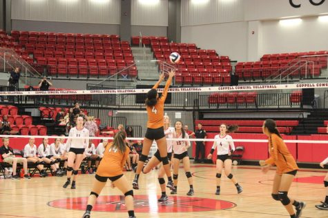 W.T. White Middle Blocker, number four, leaps up to block the Cowgirls from scoring at the game against W.T. White Tuesday night in the arena. The Cowgirls won each set 25-3, 24-5, and 25-7 with a huge lead each time. Photo by Hannah Tucker.