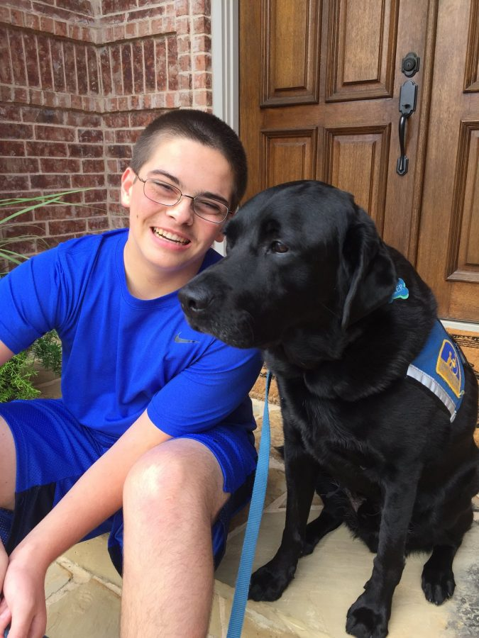 Adam+O%27Day%2C+a+15-year-old+student+at+Keller+high+school%2C+sits+with+his+service+dog+Tyler.+O%27Day+and+Tyler+will+speak+at+the+annual+DogFest+at+Canine+Compaions+for+Independence+South+Central+Location+on+Oct.+1.+Photo+courtesy+Anna+O%27Day.