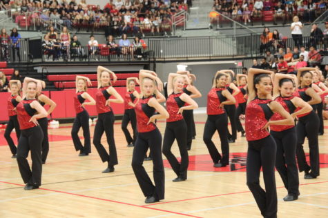 Coppell High School Lariettes perform a dance routine during the pep rally on Friday morning. Students engage in pep rally activities and cheer on the girls on in preparation for the football game against Allen.