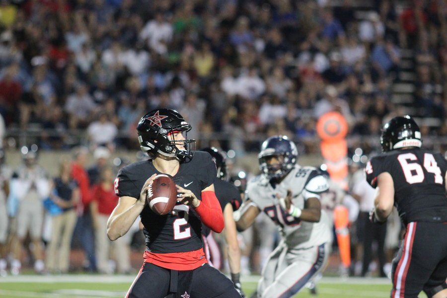 Junior quarterback Brady McBride loads up to pass in the Cowboys' 42-20 loss to Allen on Sept. 9 at home. Coppell football goes head-to-head against Jesuit this Friday.
