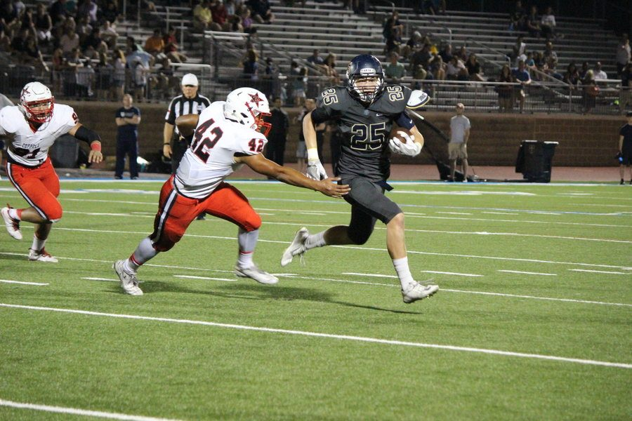 Jesuit Dallas junior running back Hank Clements evades Coppell High School junior linebacker Thomas Edwards in Coppell's 41-10 defeat to Jesuit on Friday night. The Cowboy defense allowed 188 rush yards on the evening at Postell Stadium.