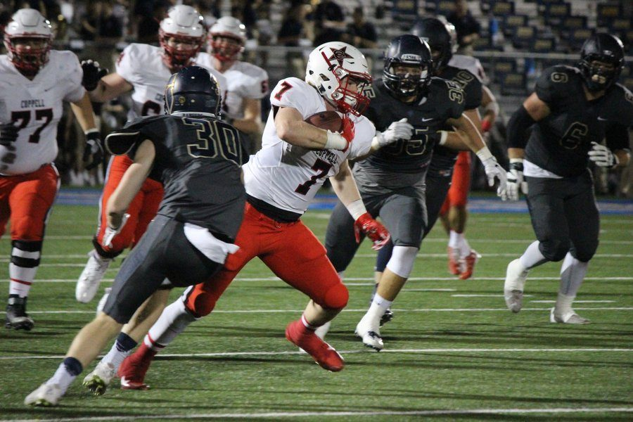Coppell High School senior running back and safety Joe Fex runs by Jesuit Dallas defense in the Cowboys' 41-10 defeat to Jesuit on Friday night at Postell Stadium. Fex scored Coppell's only touchdown during the third quarter after being out due to injury since Coppell's first game.
