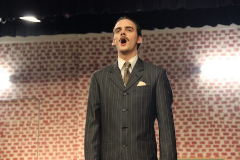 Coppell High School theater senior Ty Dalrymple sings a portion of a song from the Coppell Theater's current musical, 42nd Street, as a microphone check before the dress rehearsal begins Monday after school in the theater. Ty and and Jack Dalrymple are both playing lead roles in this new musical, which will be premiering Oct. 29-30 and Nov. 5-6. Photo by Hannah Tucker.