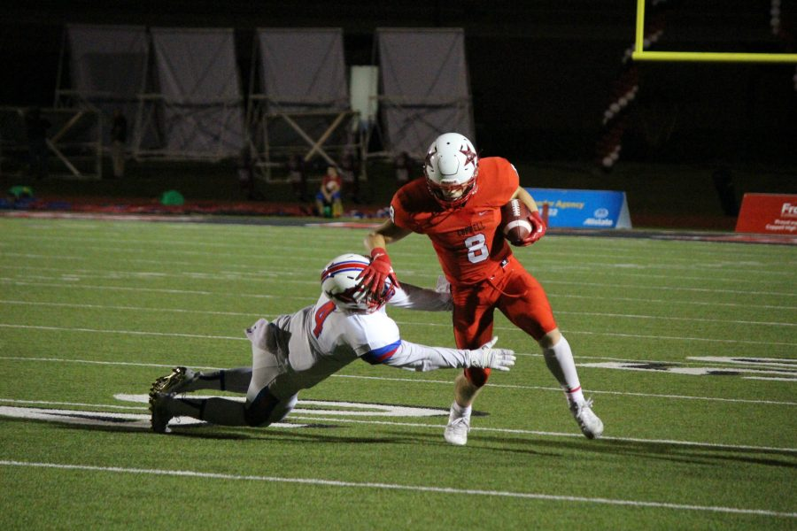 Sophomore wide receiver Blake Jackson breaks a tackle on his way to a 37-yard touchdown catch. Jackson was again the leading receiver for the Cowboys, finishing with five catches for 93 yards and two touchdowns.