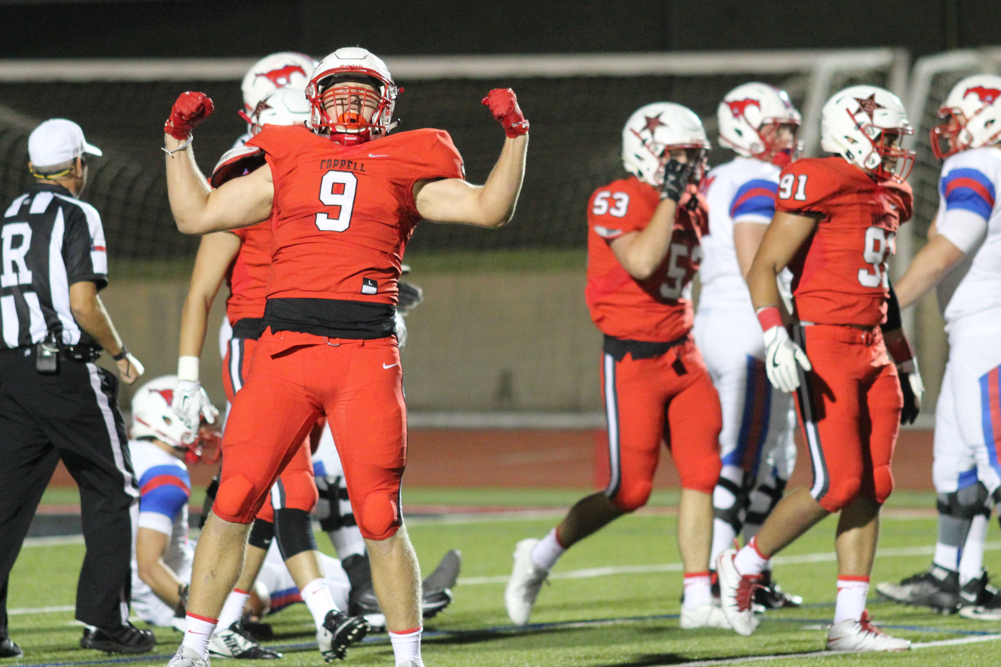Sophomore defensive lineman Jr Barker celebrates after a second quarter sack in Coppell's 48-16 win over Richardson Pearce. The Cowboys defense improved massively from last week's loss, allowing only 54 yards rushing in the game.