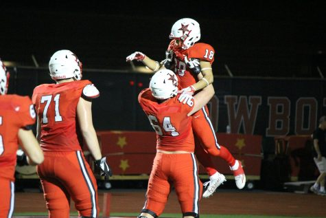 Senior wide receiver Matt Dorrity is lifted up by sophomore lineman Trevor Stange after Dorrity's 55-yard touchdown catch in Coppell's 48-13 win over Richardson Pearce. Dorrity's touchdown put the Cowboys up 28-3 over the Mustangs early in the second quarter.
