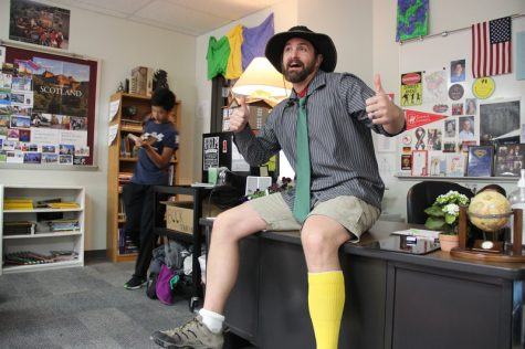 "Coppell High School history teacher Andrew Patterson shows off his mismatched outfit for Red Ribbon Awareness week in his classroom on Monday. ""I got dressed in the dark and thought I was dressed professionally, but I made a mistake,"" Patterson sincerely remarks. Photo by Hannah Tucker."