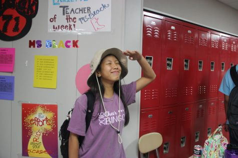 Coppell High School sophomore Sydney Nguyen laughs while showing off her wide brimmed hat as her costume for Safari Theme Day at Coppell High School on Wednesday for Red Ribbon week. Each day this week has a slogan and a dress up theme to encourage the prevention and awareness of drugs. Photo by Hannah Tucker.