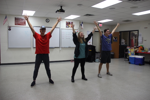 """Coppell High School seniors Jack and Ty Dalrymple practice their kickline song """"Lullaby of Broadway"""" with senior Allison Davis during their fourth period theater class on Monday. This song is part of the theater's ongoing show, 42nd Street. Photo by Hannah Tucker."""