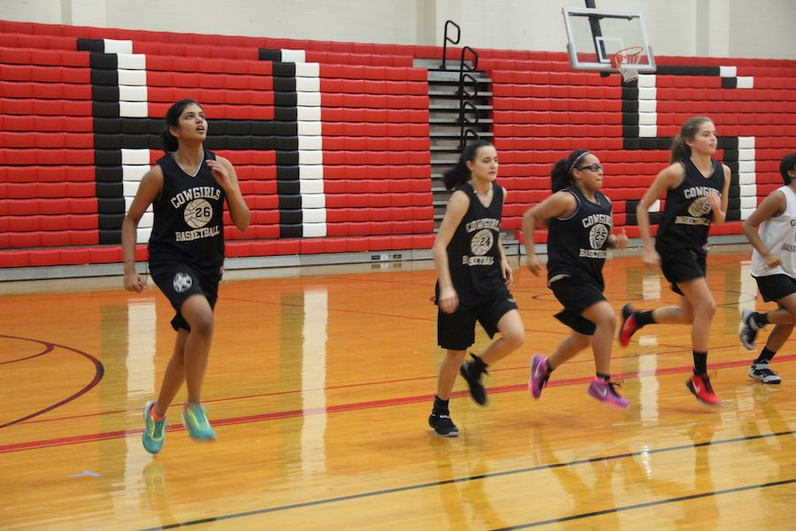 Coppell High School freshman Shrey Kottapatti runs down the court for warm up drill last Friday in the big gym. Kottapatti, who transferred to CHS from private Catholic school, The Highlands, and is now part of the Coppell Basketball team and is enjoying life at a bigger school.