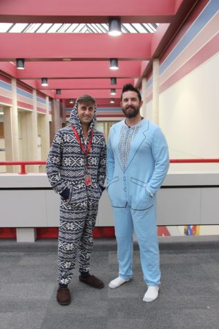 Coppell High School AP Human Geography teachers Ryan Simpson and Andy Patterson wear their go to onesies on Monday for pajama day. Both teachers dressed for comfort and to show their support for spirit week.