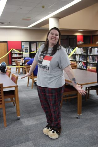 During third period on Monday, Coppell High School forensic science teacher Sandy Kirkpatirck teaches her class an assignment in the library while participating in pajama day. Kirkpatrick also showed her support for Coppell in her CHS shirt.