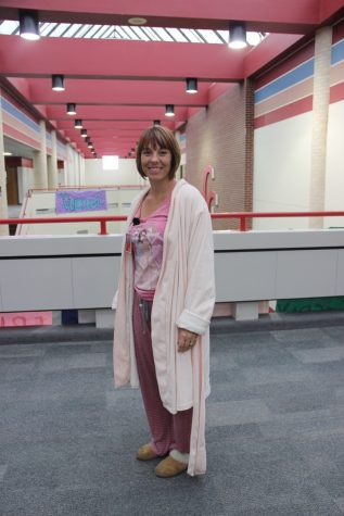 On Monday morning, Coppell High School AP chemistry teacher Amy Snyder walks down the hallway while participating in pajama day at CHS. Snyder decided to wear her favorite pink robe to show her enthusiasm and support for spirit week.