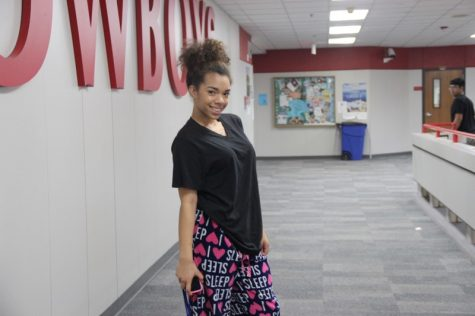 "Coppell High School sophomore Neveah Johnson dresses in her favorite PJ's that read ""I love sleep"" on Monday for pajama day. Both students and teachers were encouraged to participate in all of the spirit days to show their enthusiasm for spirit week at CHS."