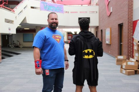 Coppell High School english teacher Sean Smith and sophomore Cory Brown sport rival superheros shirts, Batman and Superman. Students and teachers were encouraged to partake in superhero day, which was held on Tuesday at CHS.