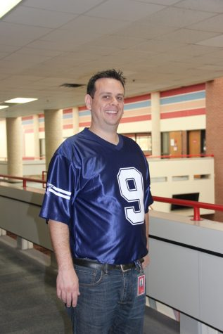 Coppell High School AP world history teacher Chris Caussey shows off his Tony Romo Jersey  for dress like a celebrity day, which was the third day of spirit week at CHS. Teachers and students were encouraged to participate in all of the spirit days to show their enthusiasm for spirit week at CHS.