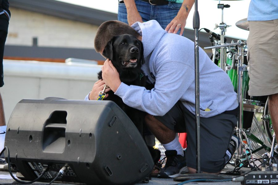 Keller High School student Adam O'Day embraces his canine companion and best friend Tyler after his speech at the second annual Dogfest DFW 2016 at the Baylor Scott & White Kinkeade Campus on Saturday. Canine Companions work with people who have mental or physical disabilities and provide service dogs free of charge.