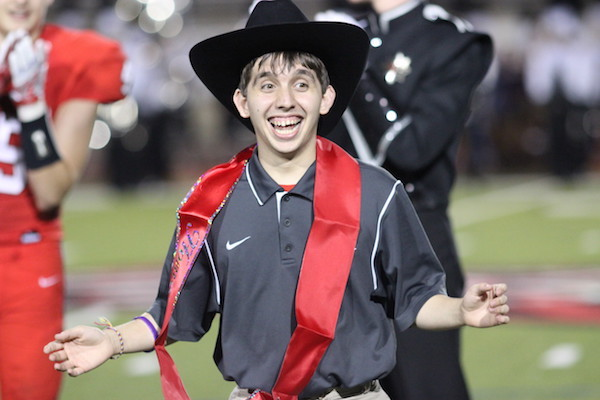 Coppell+High+School+senior+Marcus+Garza+accepts+his+homecoming+king+nomination+after+senior+Eric+Loop+appointed+him+homecoming+King+on+Sept.+30.+Homecoming+king+and+queen+were+both+announced+during+halftime+of+the+football+game+against+J.J.+Pearce.+Photo+by+Amanda+Hair.+