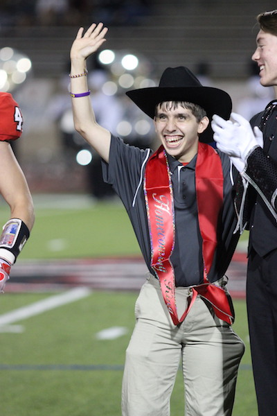 Coppell+High+School+senior+Marcus+Garza+waves+to+the+cheering+crowd+after+senior+Eric+Loop+appointed+him+homecoming+king+on+Sept.+30+at+Buddy+Echols+Field.+Both+homecoming+king+and+queen+were+announced+during+halftime+of+the+football+game+against+J.J.+Pearce.+Photo+by+Amanda+Hair.+