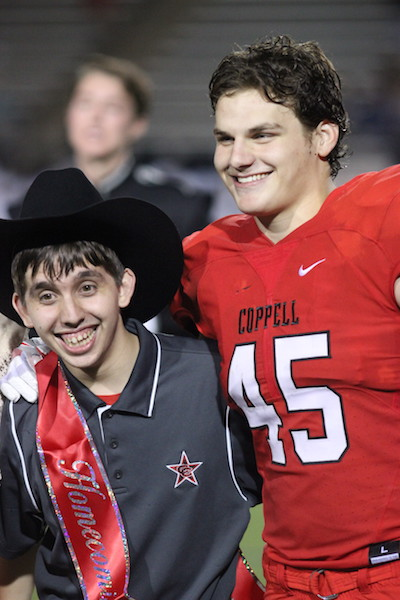 Coppell+High+School+seniors+Marcus+Garza+and+Eric+Loop+pose+for+pictures+after+Loop+was+officially+nominated+homecoming+King%2C+but+then+appointed+Garza+during+the+homecoming+game+at+Buddy+Echols+Field+on+Sept.+30.+Homecoming+king+and+queen+were+both+announced+during+halftime+of+the+football+game+against+J.J.+Pearce.+Photo+by+Amanda+Hair.