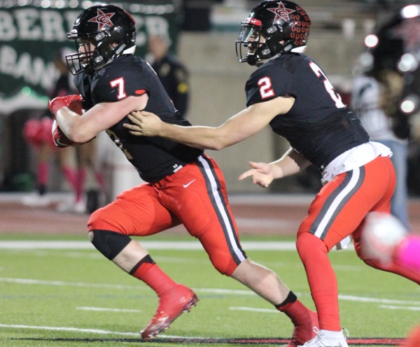 Coppell High School  junior quarterback Brady McBride hands off the ball to senior running back Joe Fex for him to later run 20 yards for a Cowboys first down during the second quarter of Friday night's game at Buddy Echols Field. The Cowboys beat Berkner 42-7 to move on 4-1 in District 9-6A play.