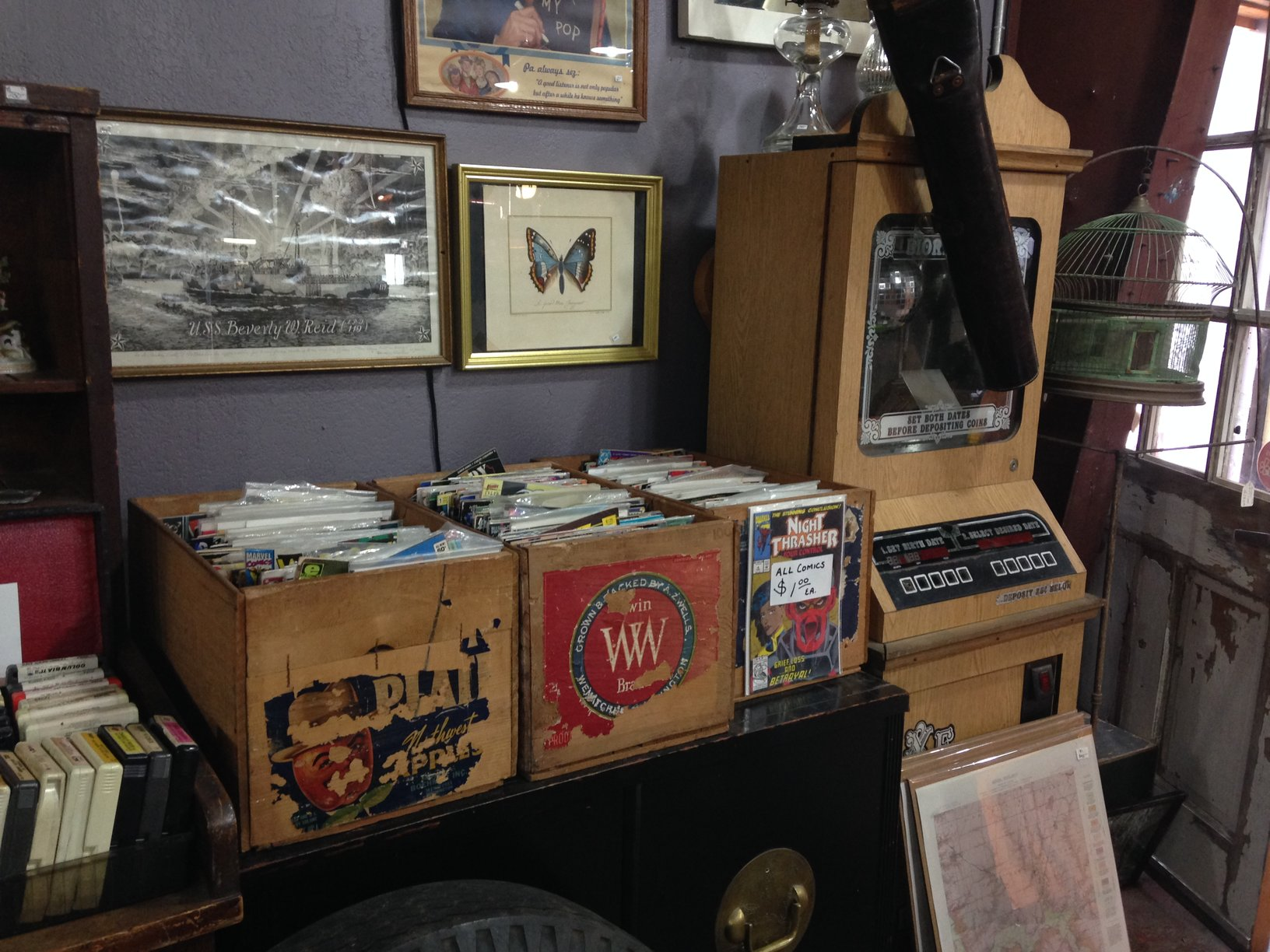 Records, old pictures, and DVDs are sold at M'Antiques, an antique store in Bishops Arts District. Bishops Arts District is home to many antique and vintage stores.