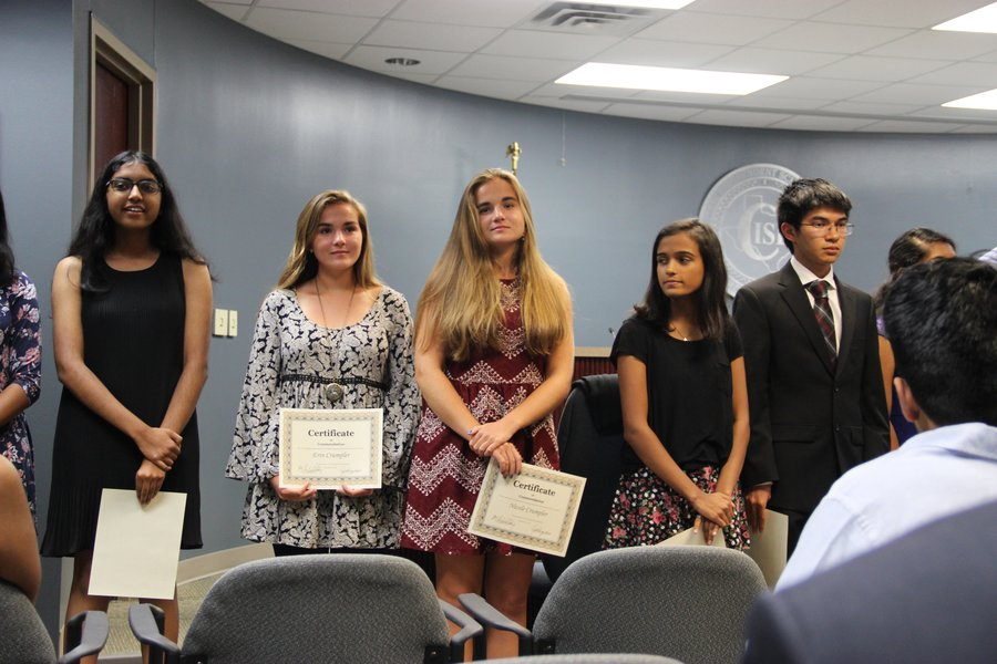 Coppell High School seniors Nikita Belathur, Erin Crumpler, Nicole Crumpler, Amruta Deole, and Nicholas Gonzalez receive the National Merit Semifinalist award during Monday night's board meeting at Coppell ISD building. Students spoke about their post high school plans after receiving their award.