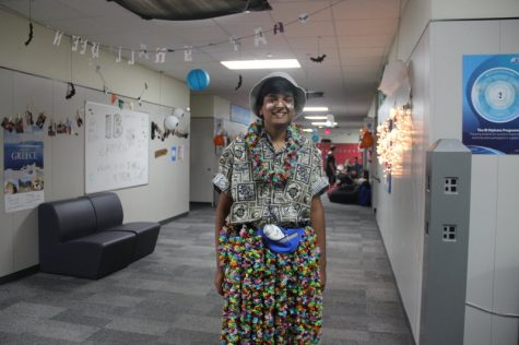 Coppell High School junior Surya Ramakrishnan makes a scene in his floral skirt and shirt, accessorized with a fishing hat, sunscreen streaks and fanny pack on Thursday at Coppell for Tacky Tourist day. Each day this week there has been a theme and quote encouraging drug prevention for Red Ribbon Week. Photo by Hannah Tucker.