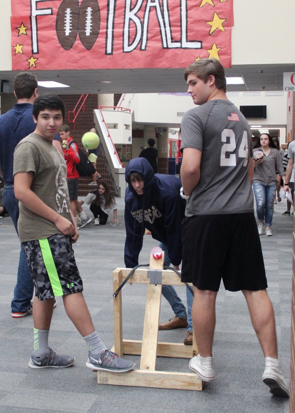 Coppell+High+School+juniors+Juan+Pablo+Gonzalez%2C+Tyler+Arnold+and+Nick+Thurman+launch+a+catapult+during+Evan+Whitfield%E2%80%99s+fifth+period+physics+class+today.+The+physics+department+is+currently+learning+about+Newton%E2%80%99s+Laws+of+Motion.+