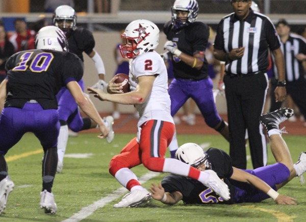 Coppell+High+School+junior+quarterback+Brady+McBride+carries+the+ball+past+the+Berkner+defense+on+Friday+night%E2%80%99s+sound+52-0+victory+over+the+Eagles+at+Eagle-Mustang+Stadium.++Coppell+heads+into+the+playoffs+riding+a+six+game+win+streak.