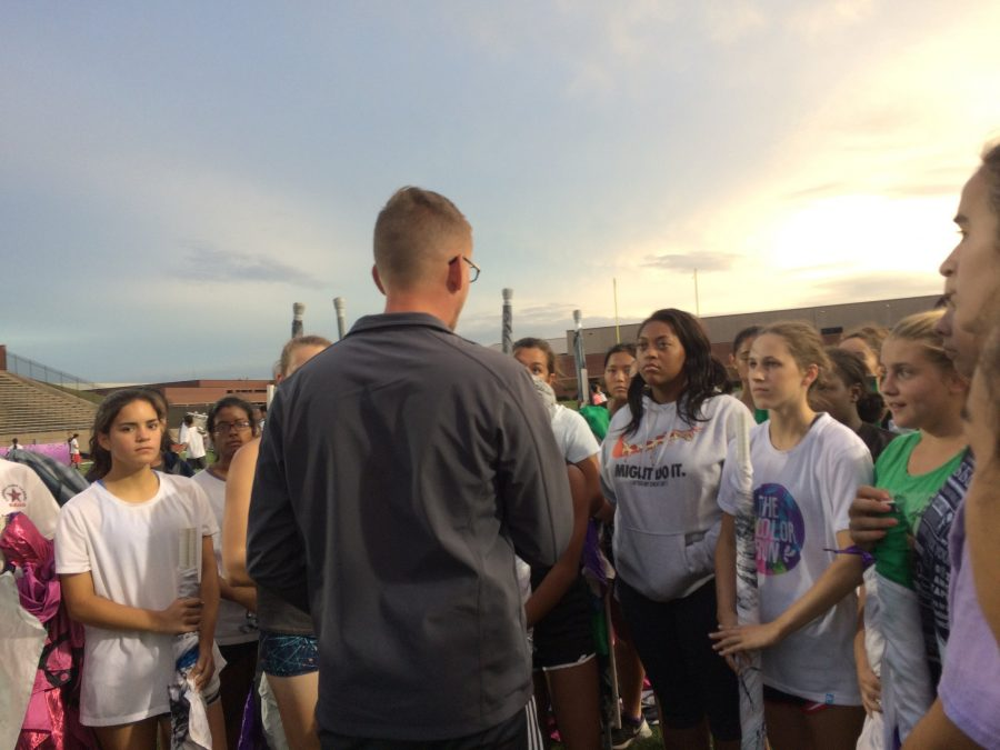 Coppell High School color guard director Matthew Rummel speaks with the color guard at Buddy Echols Field after their practice on Saturday. The band had a send off performance Saturday night before their departure for state in San Antonio.