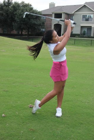 Coppell High School freshman Alyson Immanivong practices her swing on Wednesday at Riverchase Golf Course. Immanivong has been golfing for four years and is the only current freshman on the varsity golf team.