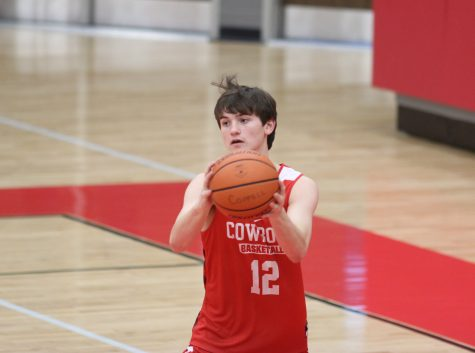 Coppell High School junior James Pietrowiak passes the ball during practice on Friday, Nov. 6 after school in the arena. The Cowboys won their season opener 64-54 against McKinney Boyd last Tuesday.