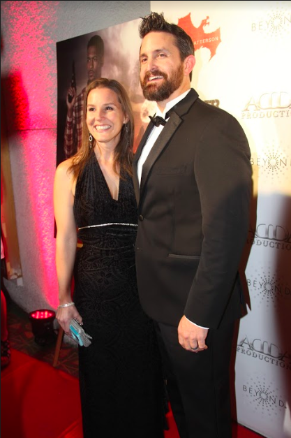 Coppell High School Human Geography teacher and director Andrew Patterson stands with his wife Lara Patterson at the Prepper Red Carpet Premiere at Texas Theatre on Nov. 19. Pattersons short film, set in an apocalyptic world, featured several CHS students. Photo by Kelly Monaghan.