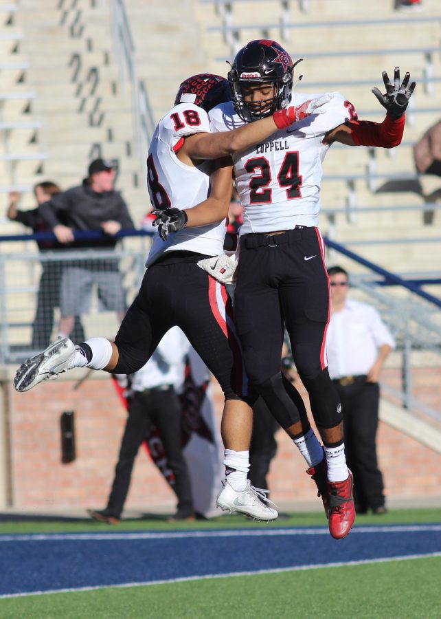 Senior wide receiver Matt Dorrity celebrates with junior wide receiver Gabe Lemons after one of Dorritys two scores in Coppells 29-25 defeat of Rockwall.  Coppell will play Round Rock at 2 p.m. on Saturday, Nov. 26 in Waco.
