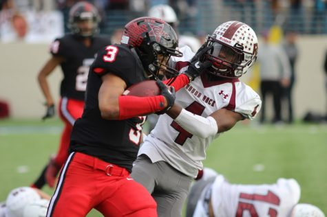 Coppell High School sophomore free safety Jonathan McGill dodges an attempted tackle during the third quarter of Saturday's playoff game at WISD Stadium. After a close matchup, Round Rock defeated Coppell with a final score of 49-45 in the regional semifinals.