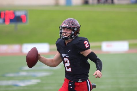 Coppell High School junior quarterback Brady McBride runs the ball into the end zone during the second quarter of Saturday's game at WISD Stadium. The Coppell Cowboys fell to the Round Rock Dragons with a final score of 49-45 after a close matchup in the regional semifinals.