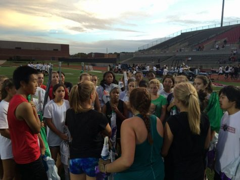 Coppell High School color guard director Matthew Rummel speaks with the color guard at Buddy Echols Field after their practice on Saturday. The band had a send off performance Saturday night before its departure for state in San Antonio. Photo by Hannah Tucker.