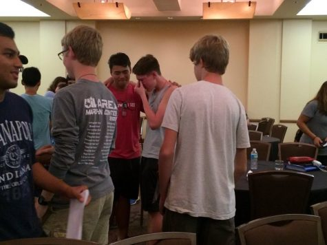 Coppell High School senior Kyle Whiting lets out his tearful emotions to fellow band mates at the band meeting on Nov. 7 in the meeting hall at the hotel. Many of the seniors were emotional after the band staff and a few seniors talked about the amazing season and the letters that band kids wrote at band camp during August to their future selves for end of season were opened. Photo by Hannah Tucker.