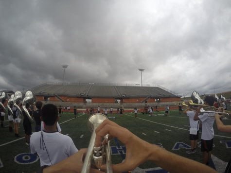 With a GoPro attached to the hat of senior trumpet player Christian Thorp, a unique perspective is given of the view of a marching band member during a show. All marchers' horn angles and positions must be uniform, and performance must be projected upwards in order to get the desired visual effect and sound. Photo by Hannah Tucker.