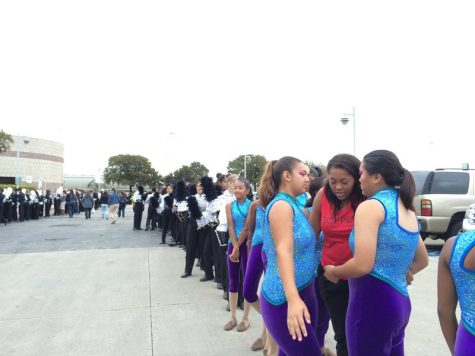 The Coppell Band lines up for finals retreat in the parking lot of the Alamodome Nov. 9. Out of around an estimated 230 Class 6A bands that take part in the UIL State competitions, Coppell emerged as a finalist at state, moving up from their 12th place in prelims and placing 11th in finals. Photo by Hannah Tucker.