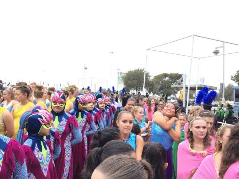 Heading to to retreat, the marching bands of Keller, Marcus, Hebron, Coppell and San Antonio Reagan High Schools lined up to file into the massive stadium for a full band retreat at the Alamodome on Nov. 9. Once on the field, each school, containing hundreds of students, sectioned off into their bands and waited for results to be announced. Photo by Hannah Tucker.
