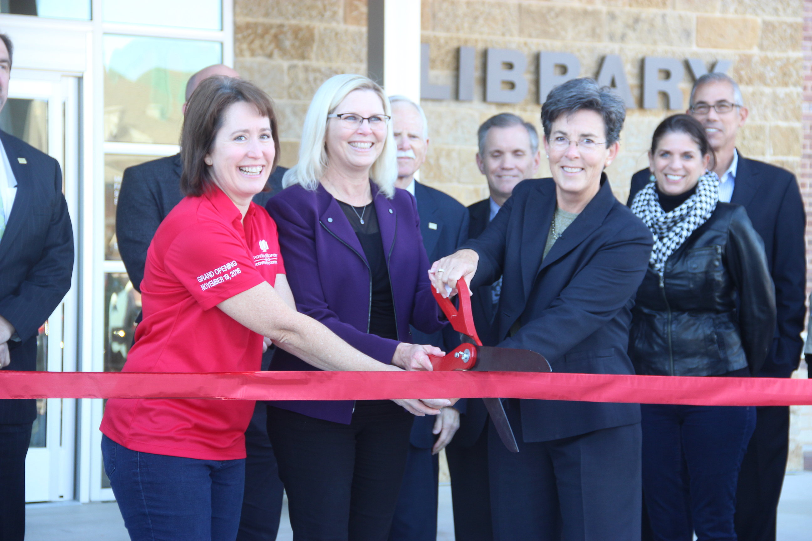 The ribbon is cut at the Grand Opening Celebration of the Cozby Library and Community Commons on Nov. 19. The event featured tours of the new building, as well as demonstrations and performances by the Fortissimo Five, James Wand and Liberation Coffee.