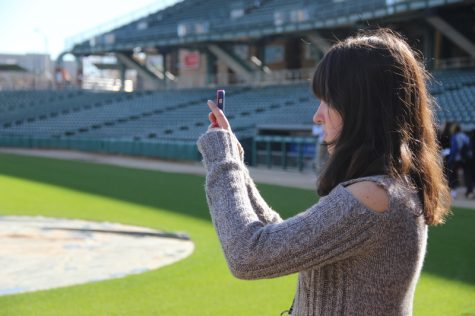 One of the many student journalist attending the JEA/NSPA Fall National High School Journalism Convention takes pictures of Victory Field as a part of an interactive session hosted by John Scott of Roberts Camera on Friday morning. Student journalists from across the country gathered in Indianapolis from Nov. 10-12 to widen their journalistic skills.
