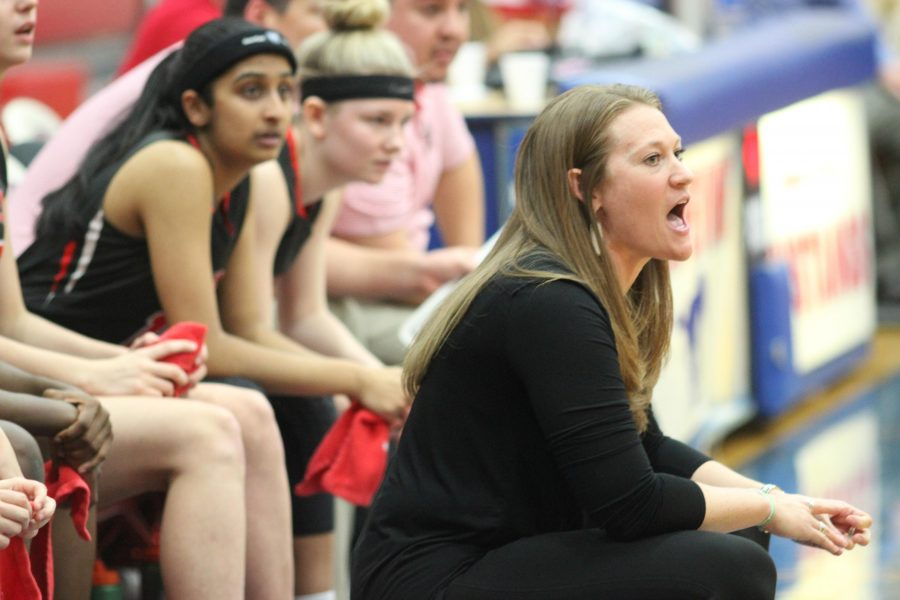 Cowgirls basketball coach Kristen Davis gives encouragement to her team from the sideline on its December 6 game.